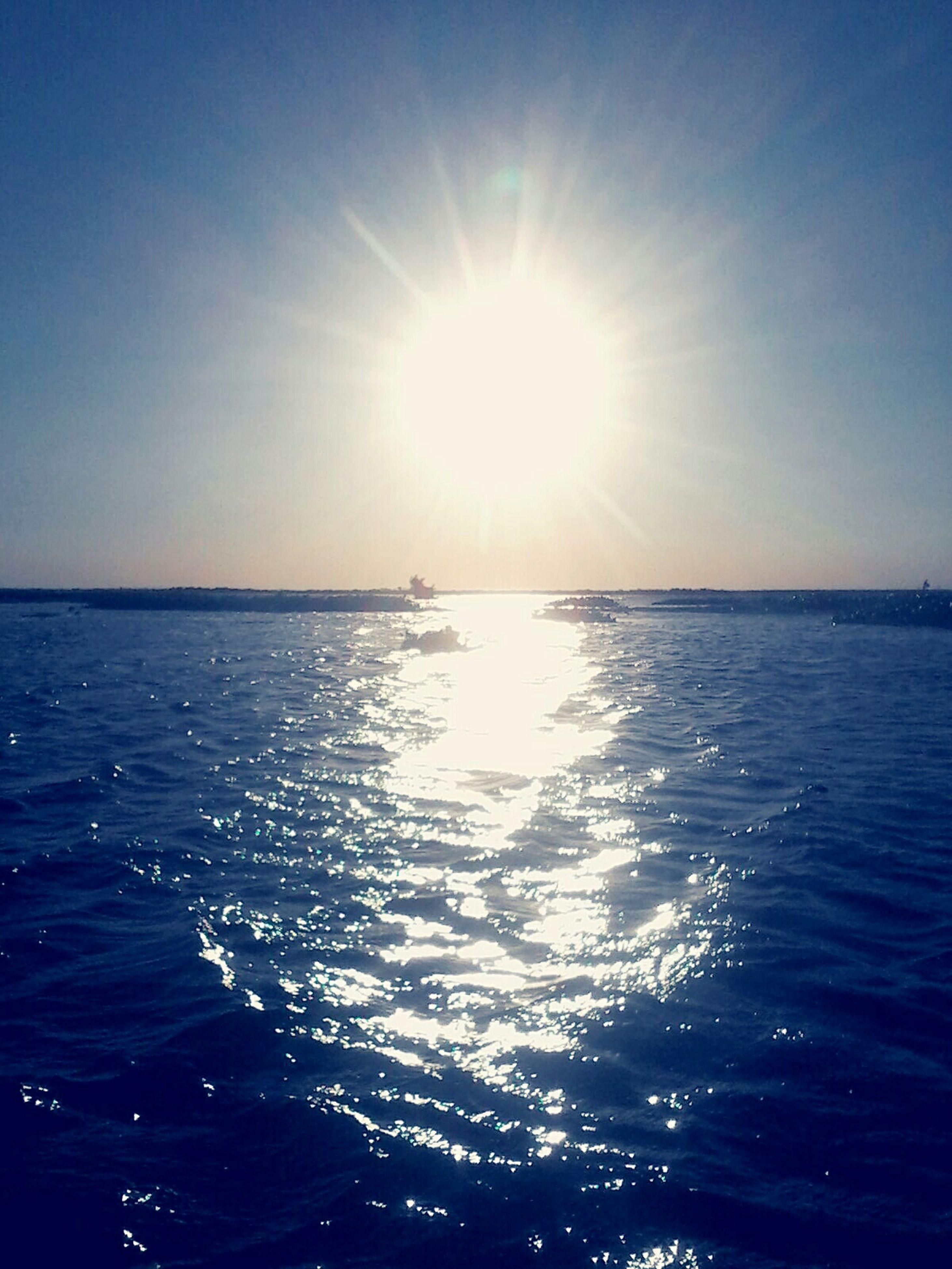water, sea, sun, horizon over water, sunlight, waterfront, tranquility, scenics, tranquil scene, beauty in nature, blue, reflection, sunbeam, rippled, nature, clear sky, sky, lens flare, idyllic, sunny