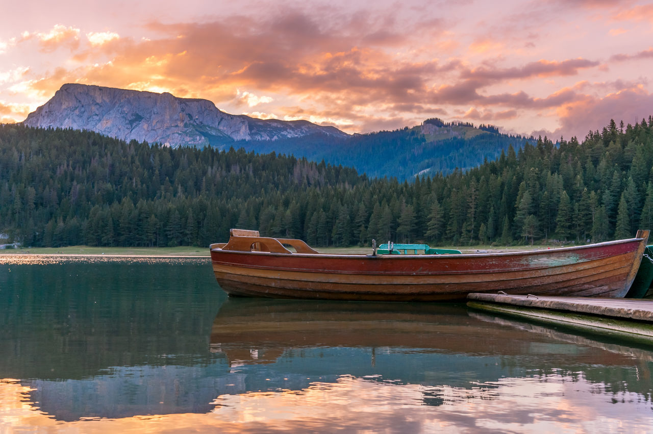 Beauty In Nature Boat Cloud - Sky Day Lake Mountain Mountain Range Nature Nautical Vessel No People Outdoors Reflection Scenics Sky Tranquil Scene Tranquility Tree Water Waterfront