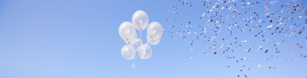 Balloons Blue Close-up Confetti Coriandoli Day Happiness Joy No People Outdoors Party Sky Sky Only Wedding White Color