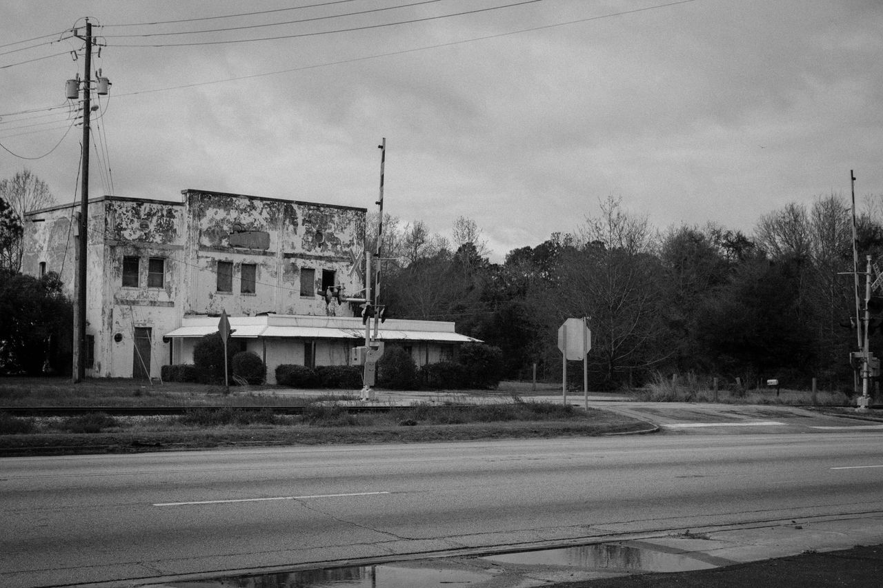 Florence,SC Road Sky Tree Street Outdoors Transportation No People Built Structure Building Exterior Electricity Pylon Architecture Day Building Exteriors Abandoned Abandoned Places Abandoned Buildings Black & White Blackandwhite