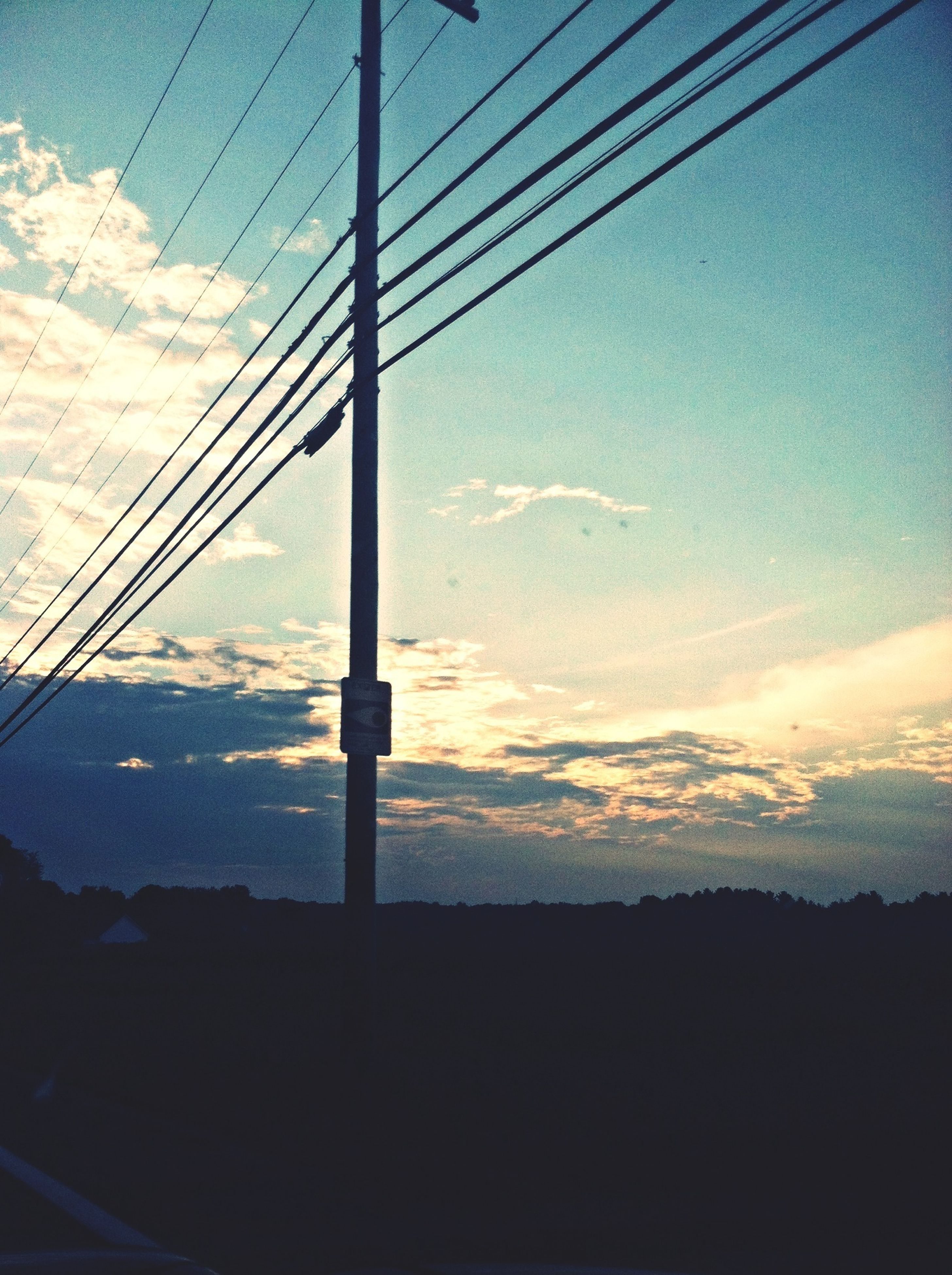 power line, electricity, power supply, electricity pylon, cable, sky, fuel and power generation, silhouette, connection, technology, low angle view, sunset, power cable, cloud - sky, cloud, no people, nature, tranquility, scenics, outdoors