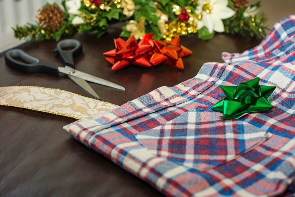 Gift wrapping a men's shirt for Christmas Christmas Christmas Present Gift No People Close-up Wrapping Men's Shirt Plaid Xmas Festive Still Life Close Up Closeup Men's Present