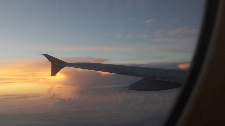 Airplane Flying Aircraft Wing Travel Sky Cloud - Sky Outdoors Day Colombia Trough The Glass Sunny Sunset Vacations Traveling Home For The Holidays