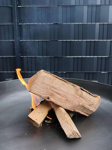 Fire Wood - Material Wood Metal Brazier Fire Bowl Burning Outdoors No People Metal Bowl Relaxing Enjoying Life Flame Smoke Garden Evening Wall Grey Close-up Bonfire