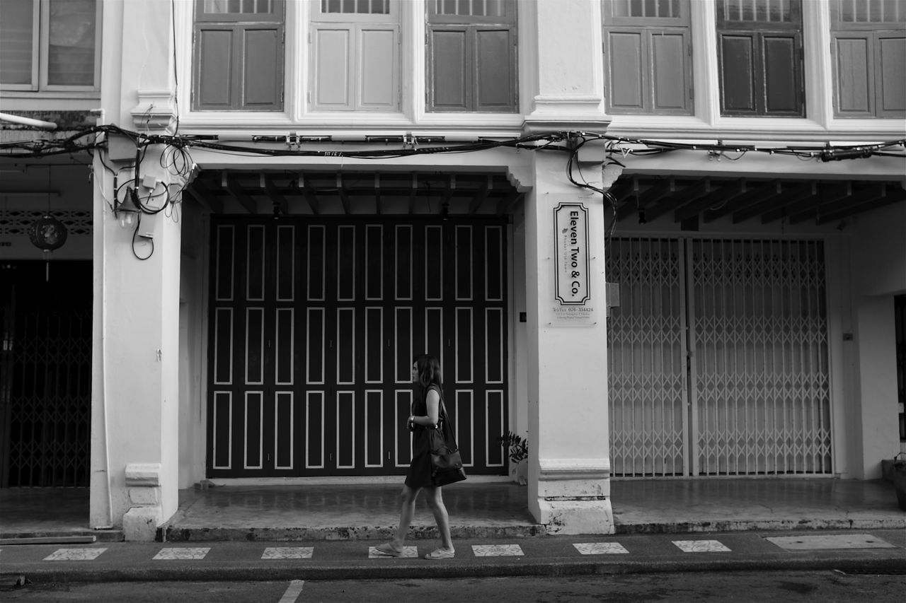 historic old towne phuket Architecture ASIA Black And White City Everybodystreet Historic One Person Phuket Street Photography Strideby Thailand Walking Wall - Building Feature Historic District Young Woman Walking Urban Travel Photography Spotted In Thailand Sino Portuguese, Old Town Storefront Facade Building Closed Store Sidewalk Carrying A Purse Skirt