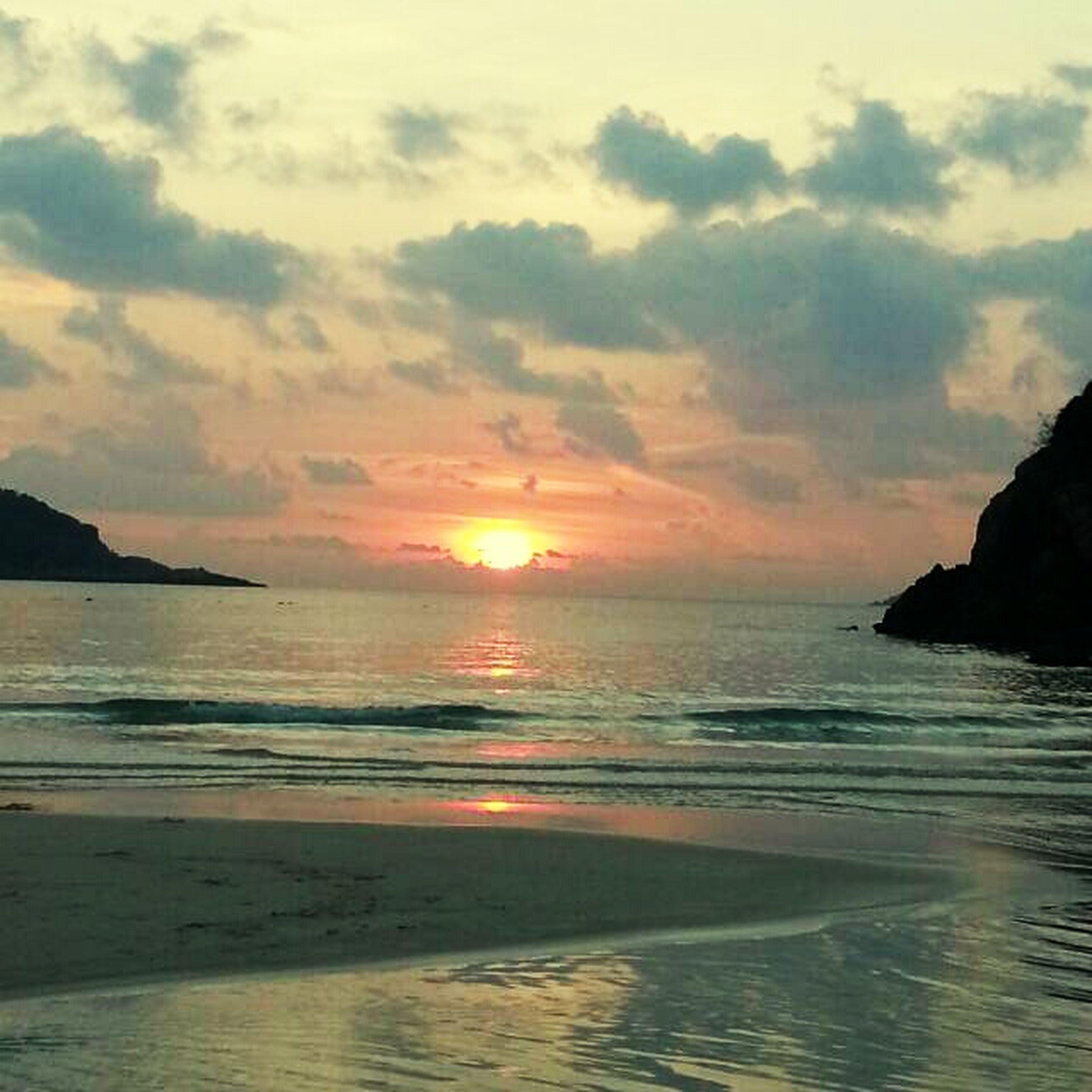 sea, water, horizon over water, sunset, scenics, tranquil scene, beauty in nature, beach, tranquility, sky, shore, sun, idyllic, nature, reflection, coastline, wave, cloud - sky, rock - object, orange color