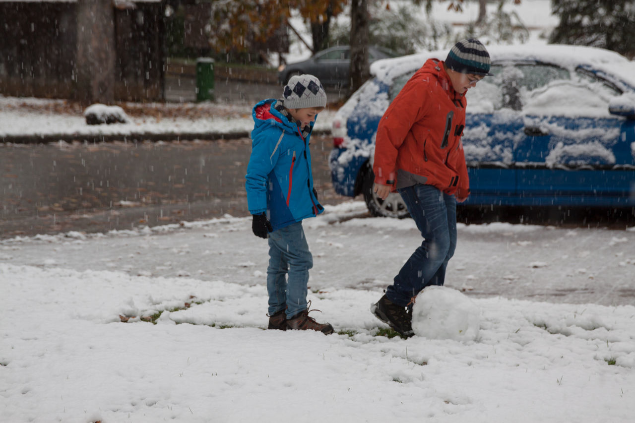 Two boys playing in fresh snow in Germany Bonding Boys Candid Child Childhood Cold Temperature Enjoyment Family Friendship Full Length Happiness Joy Leisure Activity Lifestyles Males  Offspring Outdoors Playing Snow Snowflake Togetherness Two People Vacations Warm Clothing Winter