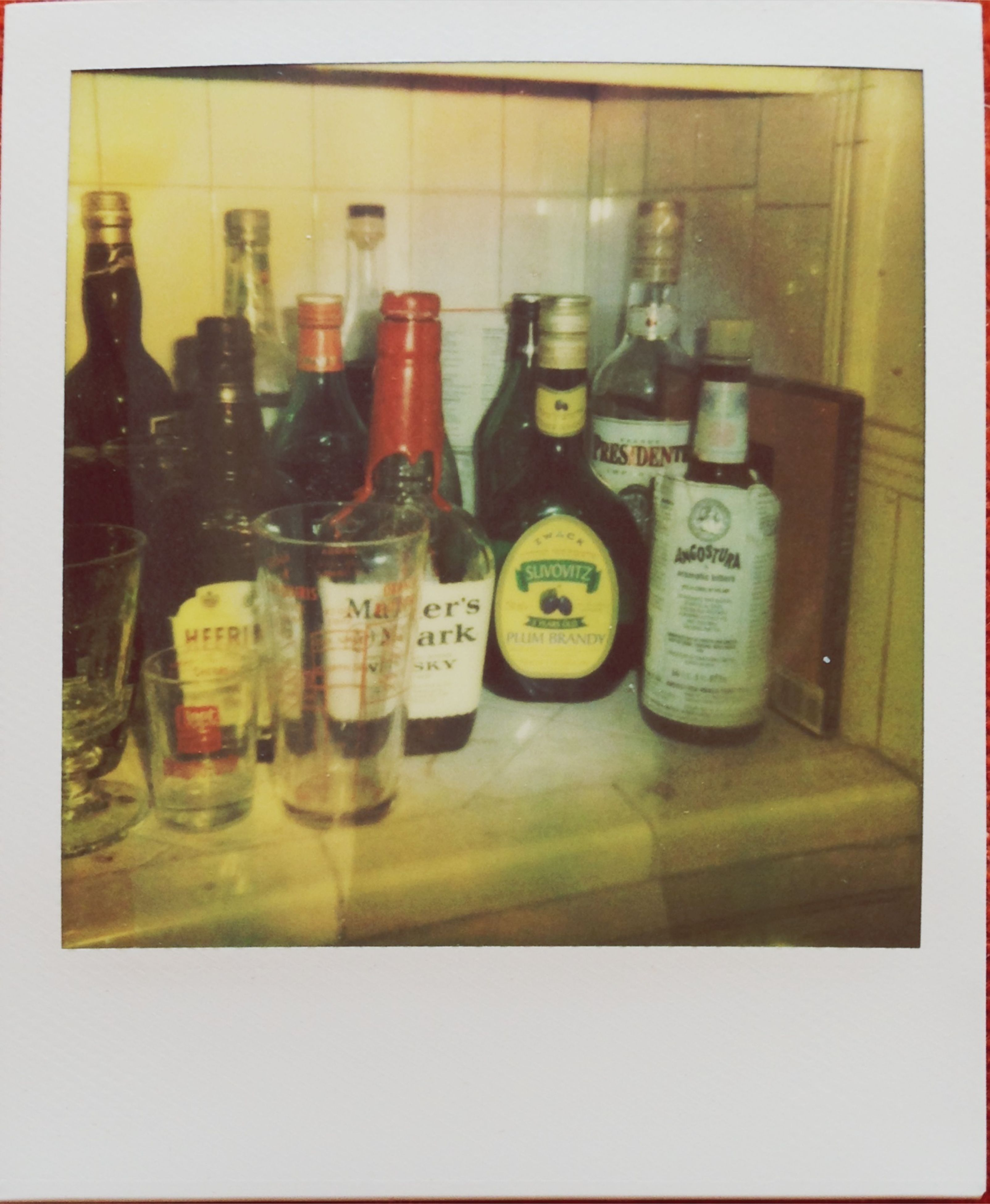 indoors, transfer print, still life, food and drink, auto post production filter, variation, table, large group of objects, arrangement, bottle, drink, glass - material, choice, close-up, shelf, jar, no people, freshness, in a row, abundance