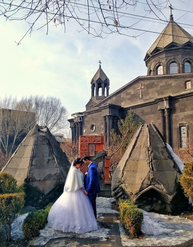 Wedding photoshoot crashed. Holy Mother Cathedral, Gyumri, Armenia Armenia Armenian Wedding Inlove Gyumri Traveltheworld TravelDestinations TravelPhotographer Caucasus Fortunate  Cathedral Ilovetravel Two People Mid Adult Mid Adult Men Bride Wedding Togetherness Outdoors Sky Adult EyeEmNewHere People Females Cloud - Sky Building Exterior EyeEmNewHere