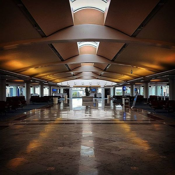 Empty airport terminal. Architecture Abstract Image created using Instagram Filters and Cameraeffects Photography at Orlando International Airport in Florida