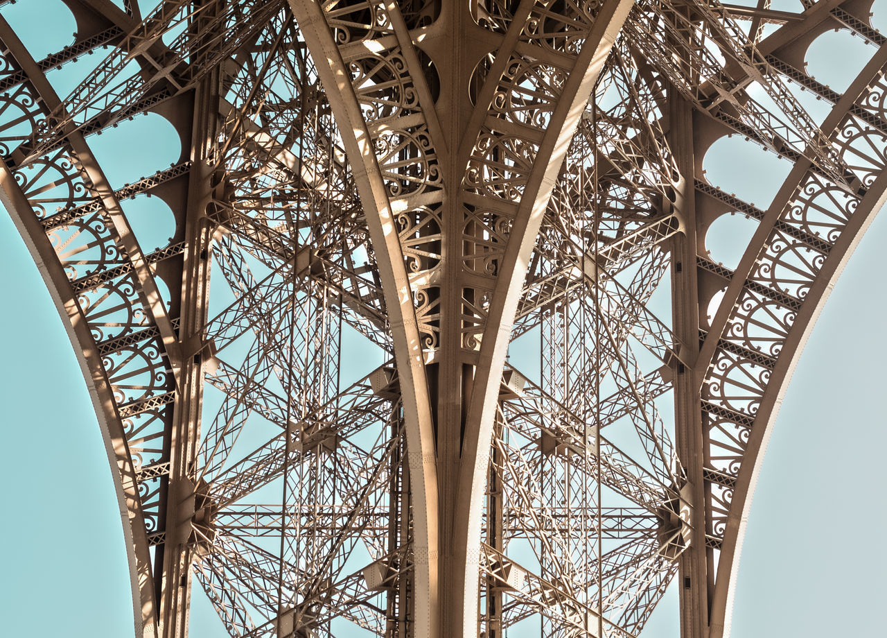 Arch Architecture Blue Brown Building Exterior Built Structure Clear Sky Connection Day Eiffel Tower Low Angle View Metal No People Outdoors Pattern Sky Symmetry