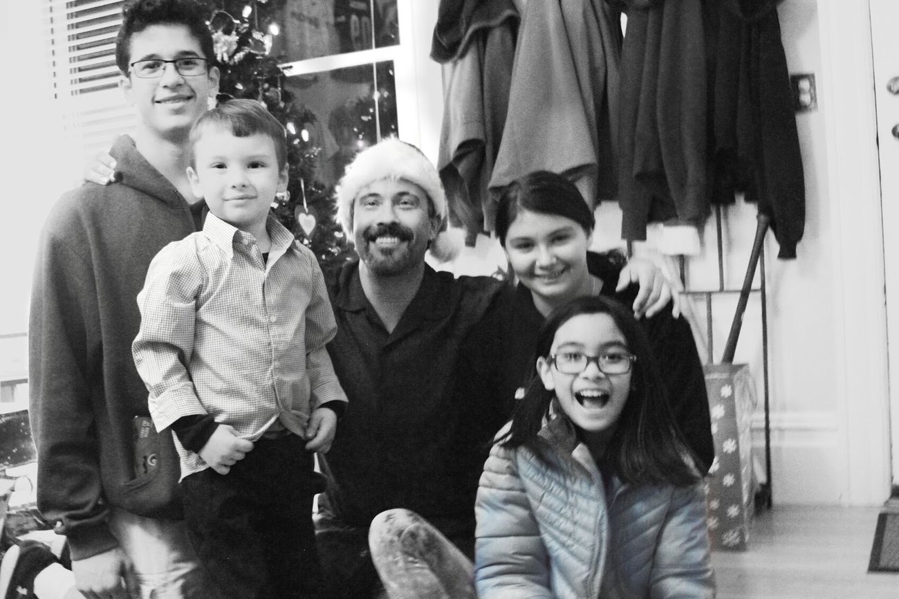 Family Christmas Smiling Togetherness Family Bonding Lifestyles People Happiness Looking At Camera Indoors  Family Time Tranquility Leisure Activity Enjoying Life Live, Love, Laugh Fun Real People In The Moments Childhood Innocence Friendship Black And White Holiday - Event Cheerful