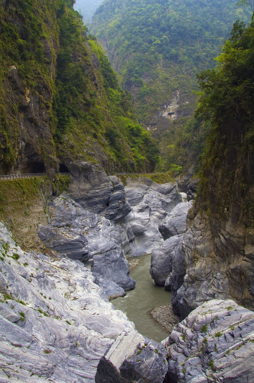 Arch Canyon Chinese Taipei Cliff Day Forest Landscape Mountain Nature No People Outdoors Quiet Rock Rock - Object Scenics Sky Social Issues Stream Taiwan Taroko National Park Traffic Tree Tunnel Water