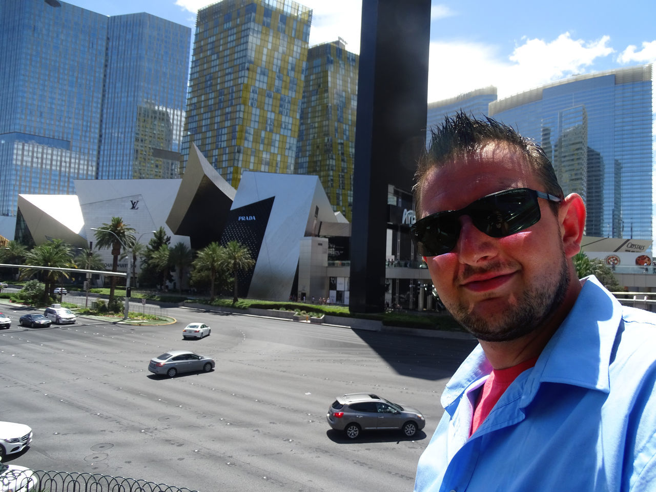 real people, architecture, built structure, sunglasses, building exterior, one person, looking at camera, young adult, day, portrait, land vehicle, outdoors, young men, lifestyles, city