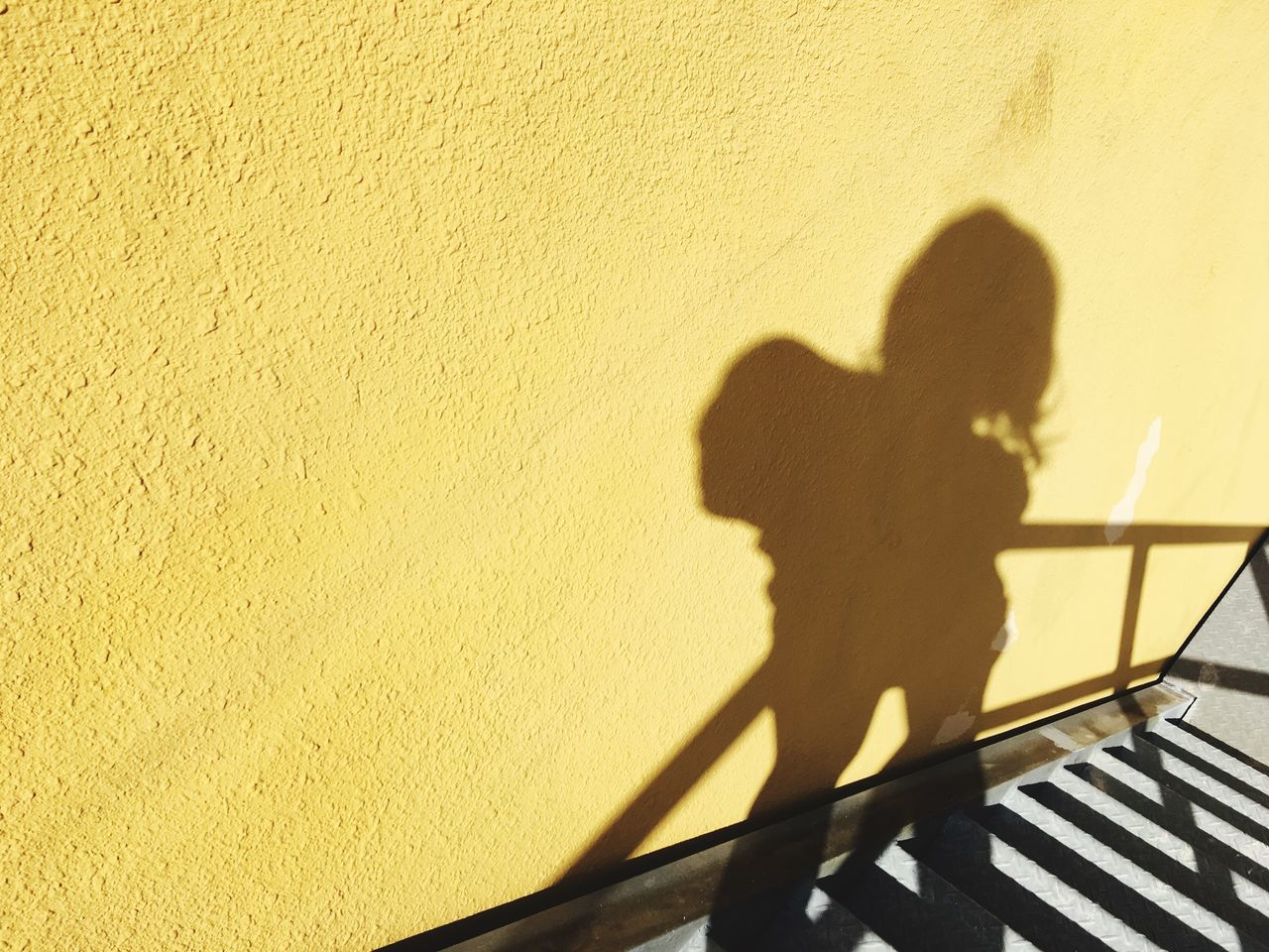 shadow, focus on shadow, sunlight, real people, one person, standing, outdoors, day, leisure activity, lifestyles, women, nature, people