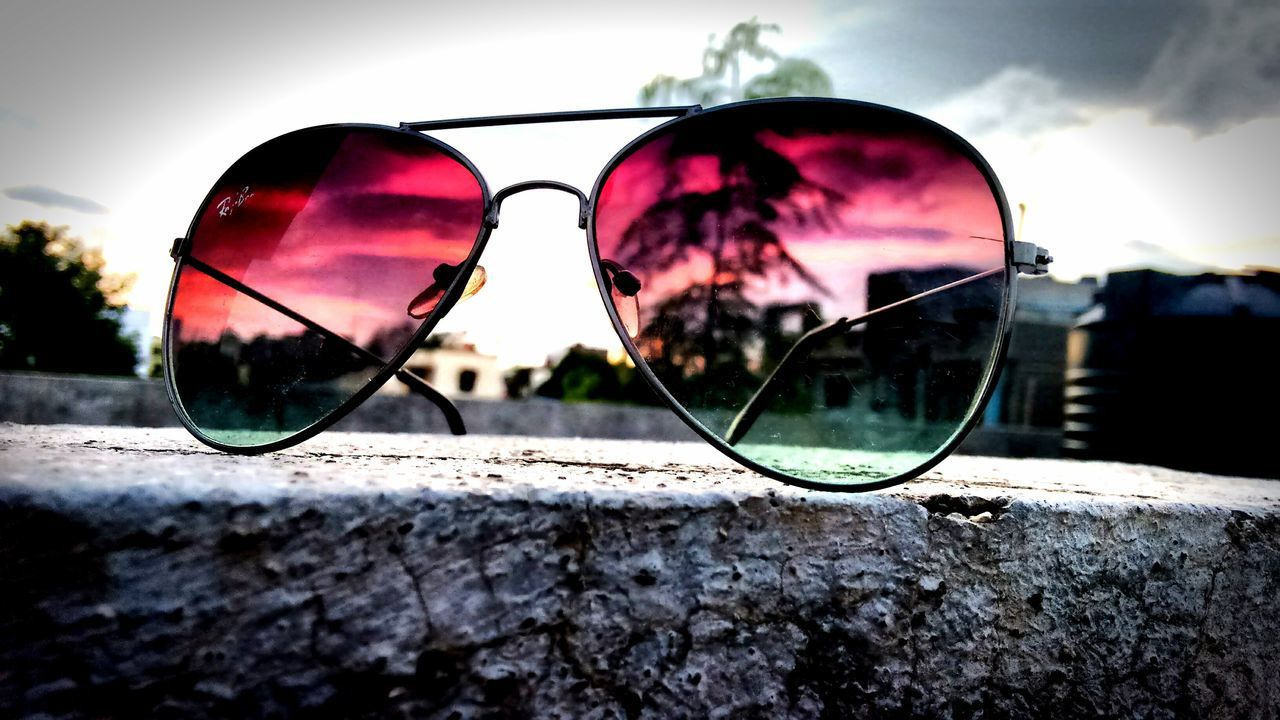 sunglasses, reflection, eyewear, eyeglasses, sky, vision, side-view mirror, glasses, outdoors, protection, day, sunset, nature, no people, water, eyesight, tree, close-up