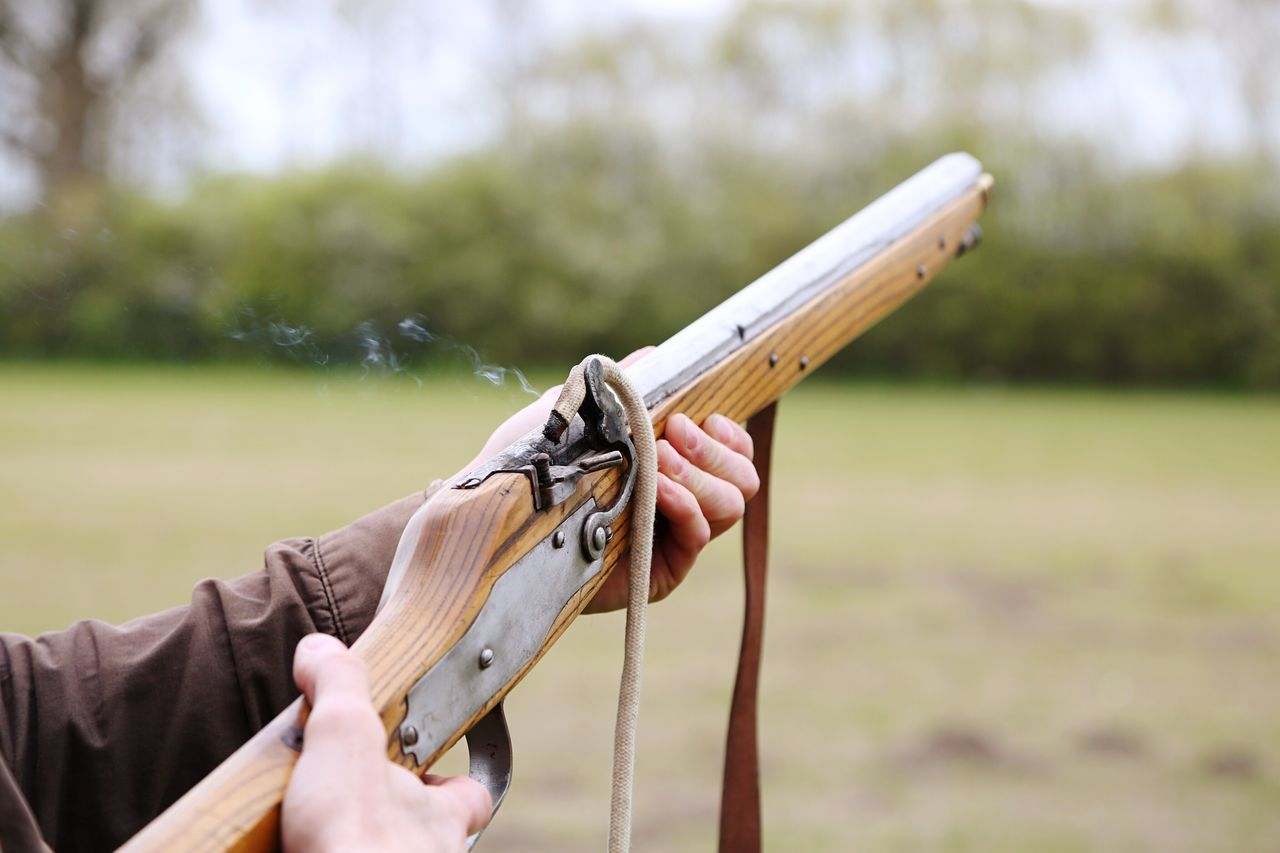 Firing an old rifle Human Hand One Person Focus On Foreground Human Body Part Holding Real People Day Close-up Outdoors Men Nature People Gun Old Vintage Rifle Firing
