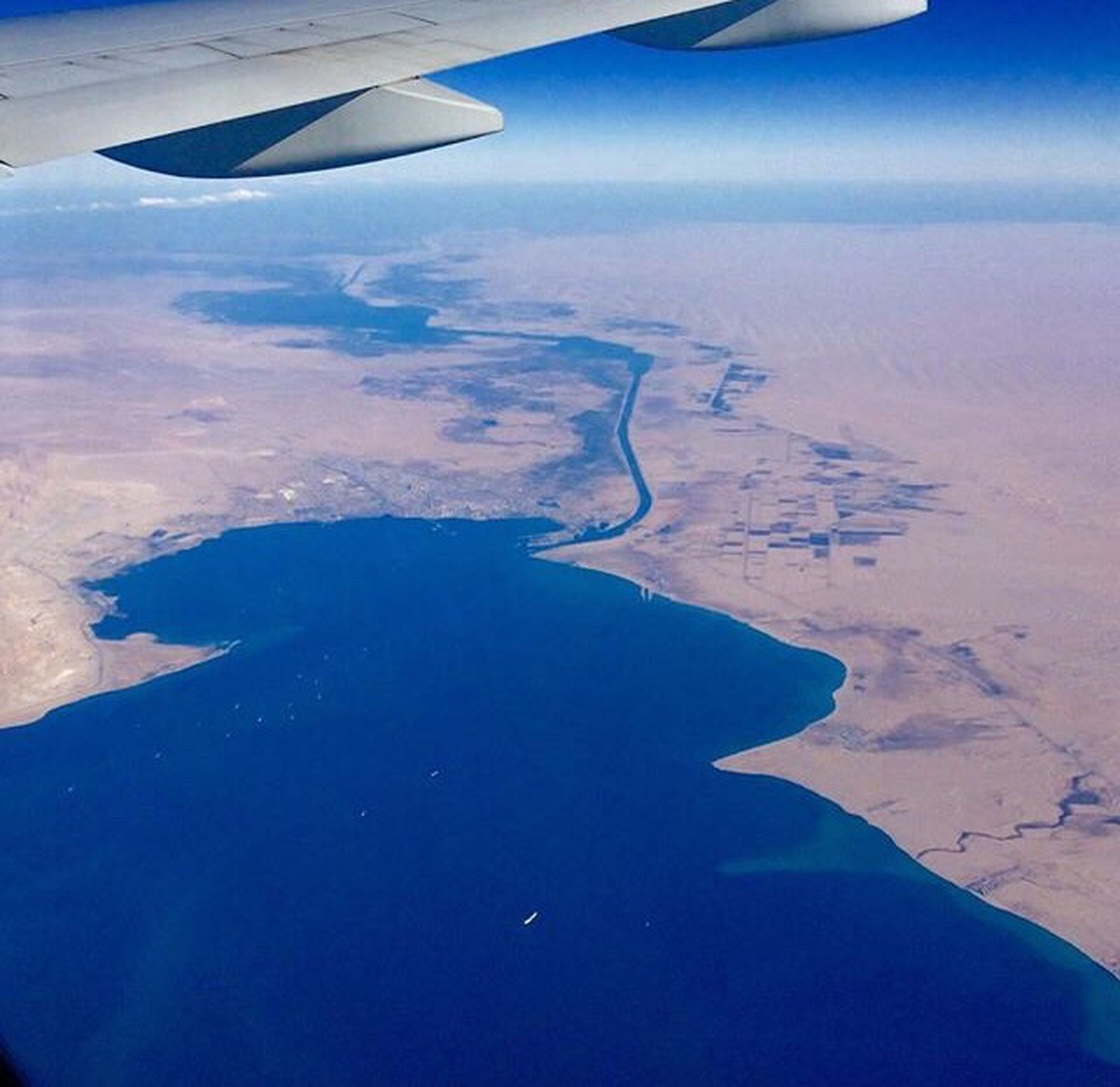 aerial view, flying, airplane, aircraft wing, travel, landscape, idyllic, tropical climate, scenics, no people, outdoors, beauty in nature, nature, water, sky, day