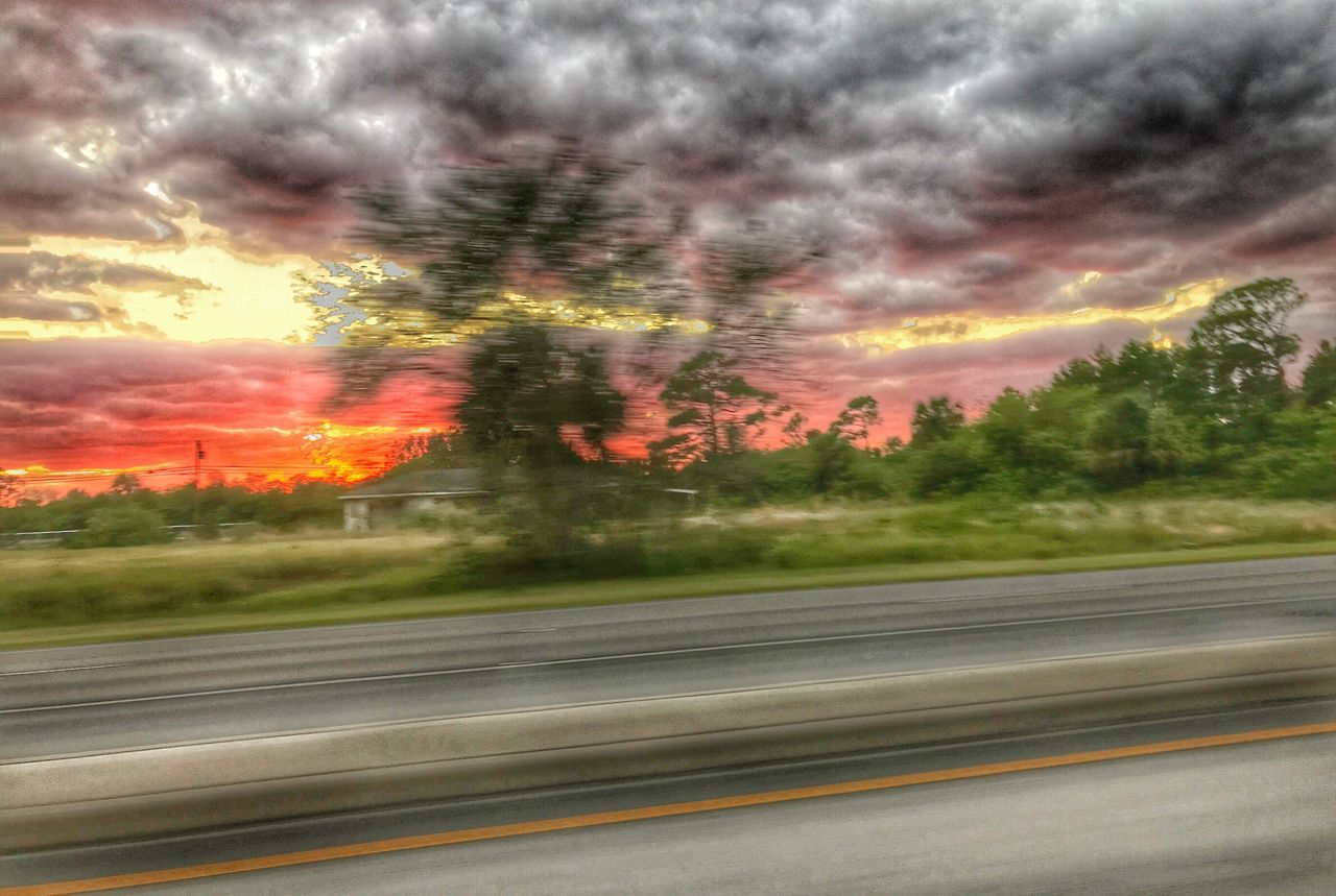 Capturing Motion Sunset On The Road got this shot (safely) while Driving Home from my meditation group. Have a great week everyone! Blurred Motion Transportation Road Nature No People Tree Landscape Speed Motion Cloud - Sky Sky Outdoors Beauty In Nature Scenics Day