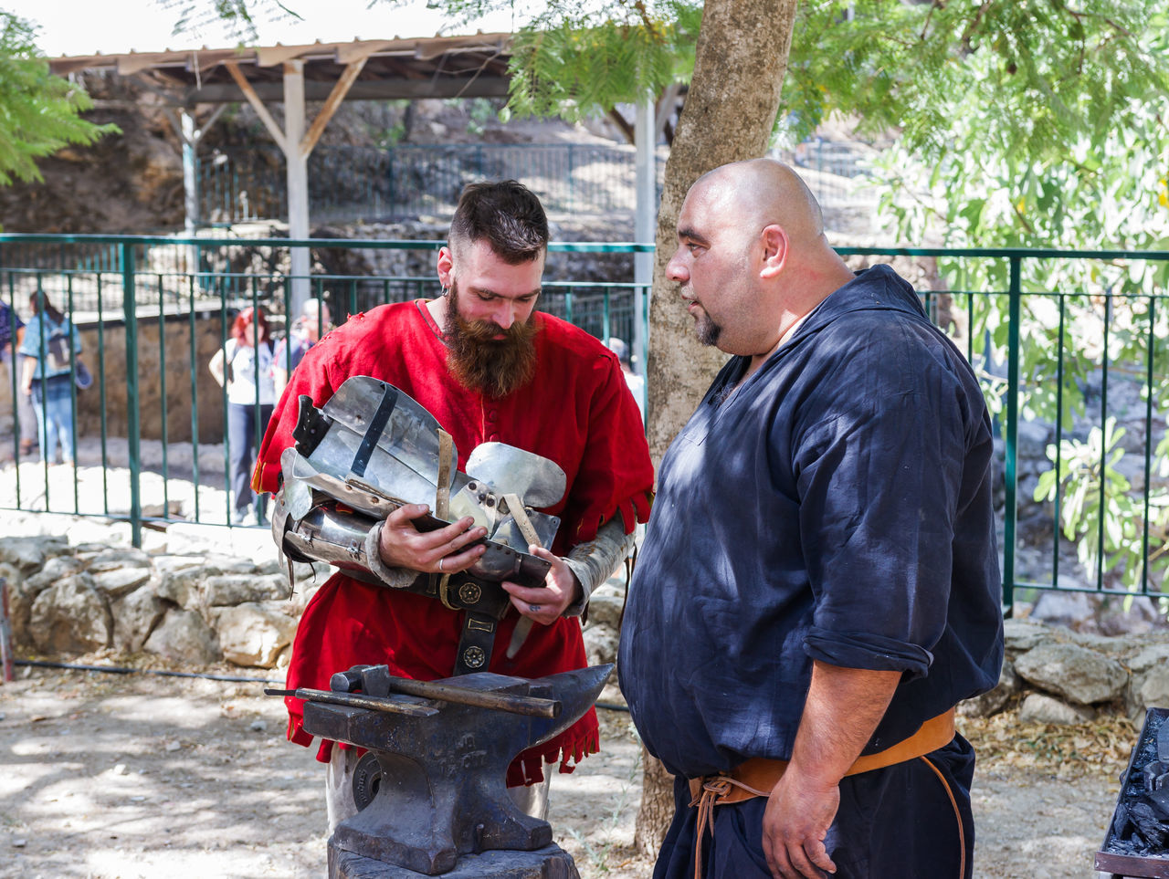 """Jerusalem, Israel, October 03, 2016: Members of the annual festival of """"Knights of Jerusalem"""" repairing armor in Jerusalem, Israel Ancient Annual Attraction Christian Citizen Decorations Dressed Event Famous Festival History Holy Israel Jerusalem Knight  Land Medieval Member Old Performance Performs Photographer Pose Sword Tradition"""