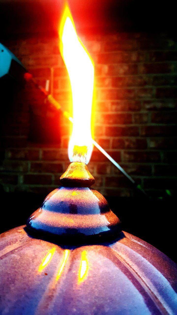 flame, burning, illuminated, glowing, candle, heat - temperature, lighting equipment, indoors, no people, close-up, night, spirituality, oil lamp, diya - oil lamp