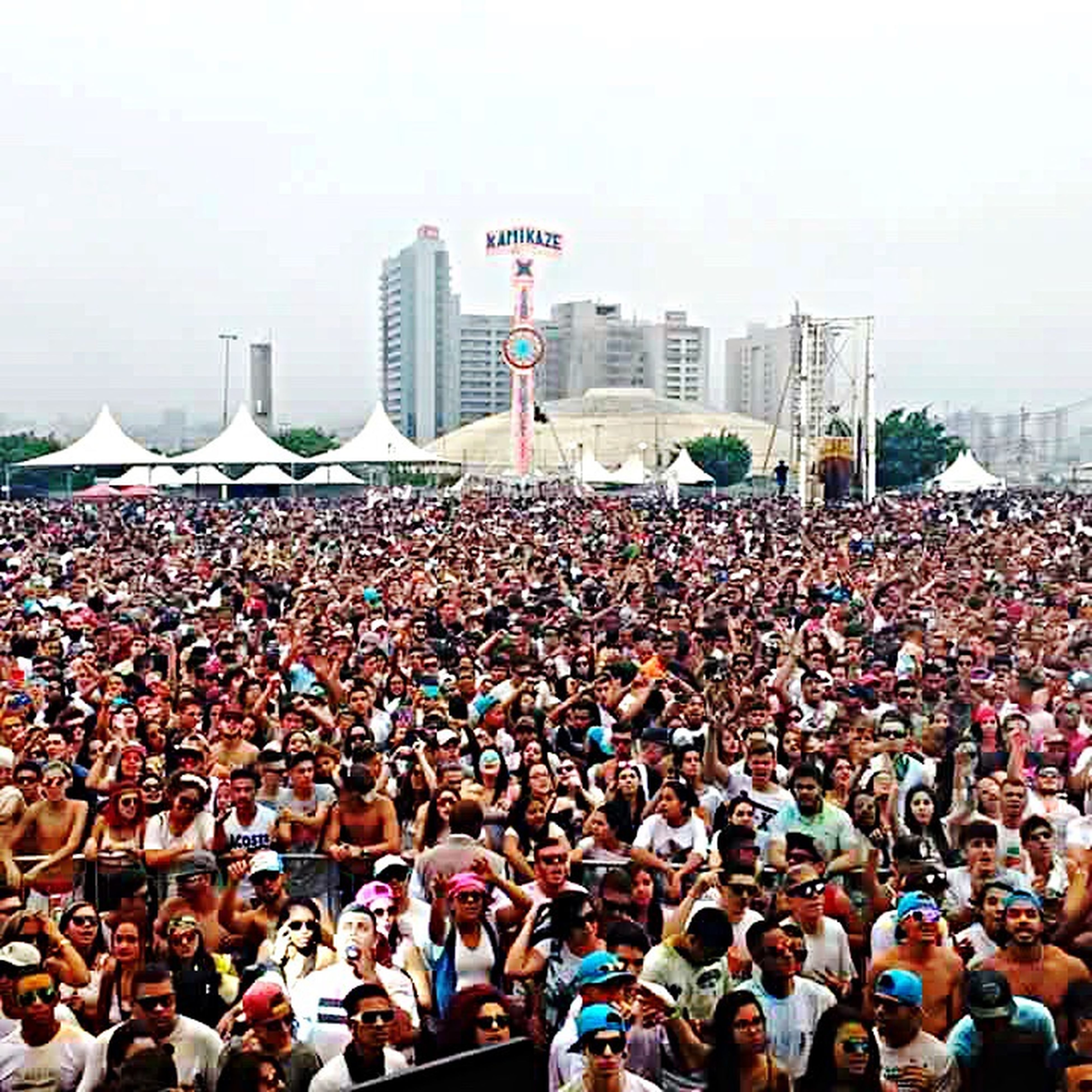 large group of people, city, crowd, building exterior, architecture, city life, men, built structure, togetherness, person, outdoors, tall - high, skyscraper, event, spectator, office building, performance, social gathering