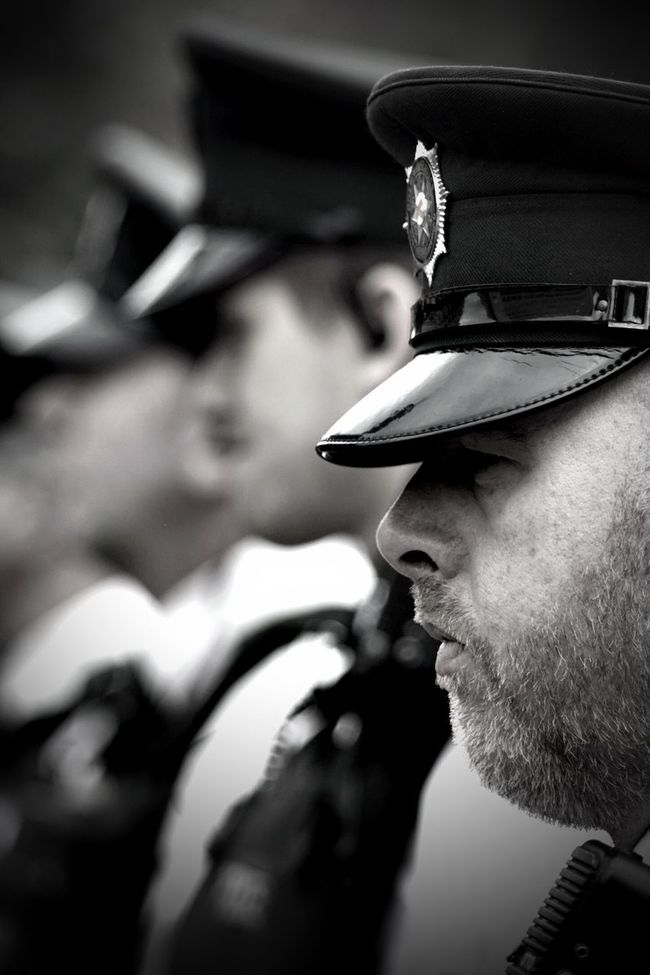 The thin blue line 50mm Blackandwhite Close-up Cropped Day Dof Focus On Foreground Lifestyles Nikkor Nikond7200 Nikonphotography Officer Part Of Police Selective Focus Streetphotography Thethinblueline