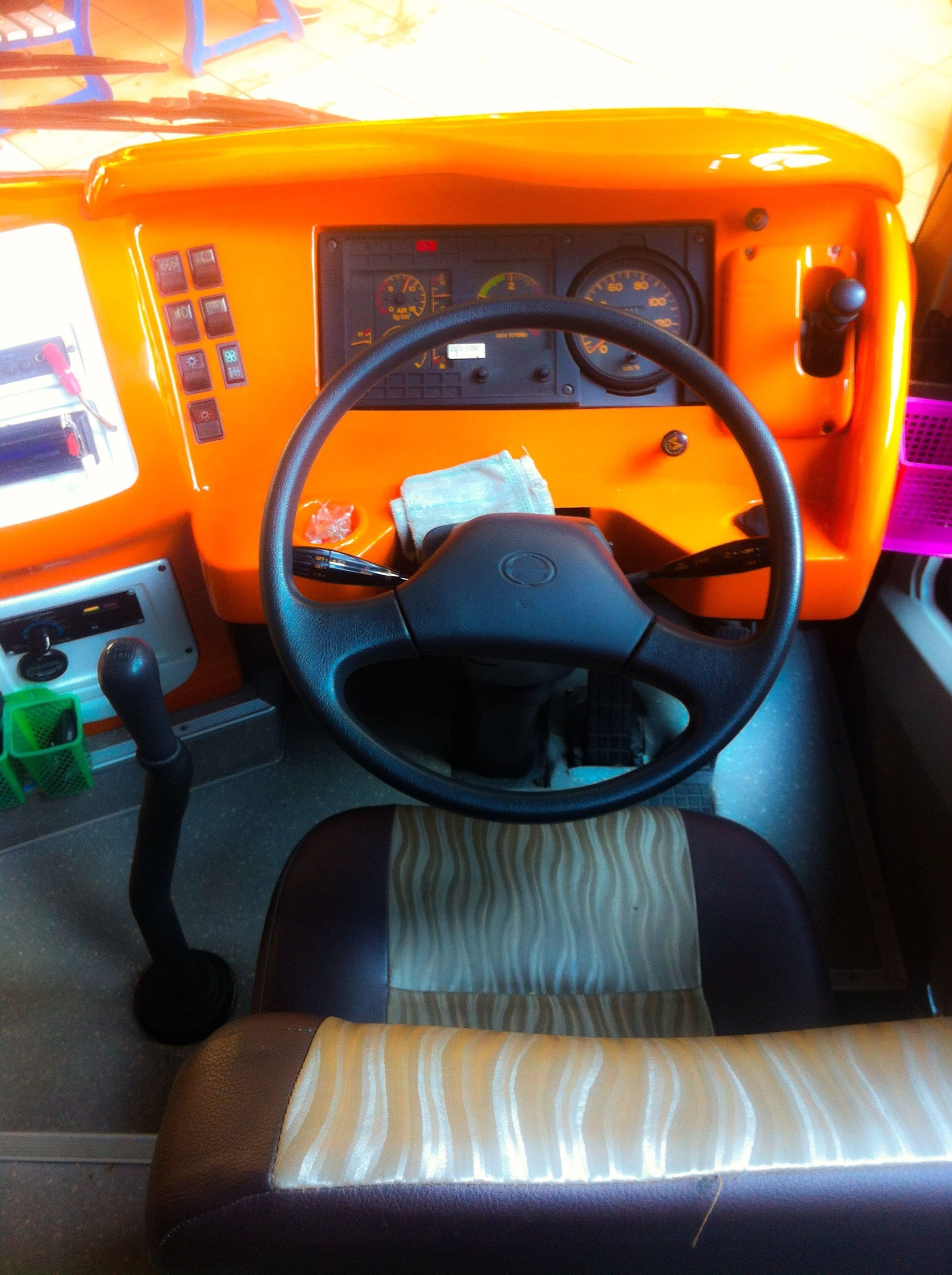 land vehicle, transportation, car, mode of transport, indoors, stationary, close-up, yellow, no people, orange color, seat, absence, still life, sunlight, day, reflection, empty, parking, chair, travel