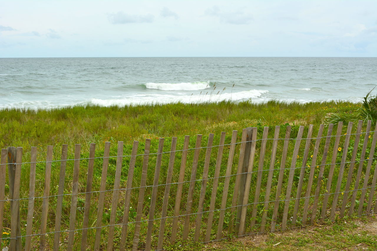 Cresting wave Beach Photography Fence Horizon Over Water No People Ocean Oceanside Sea Sea Grass Sky Water Waves Waves Crashing