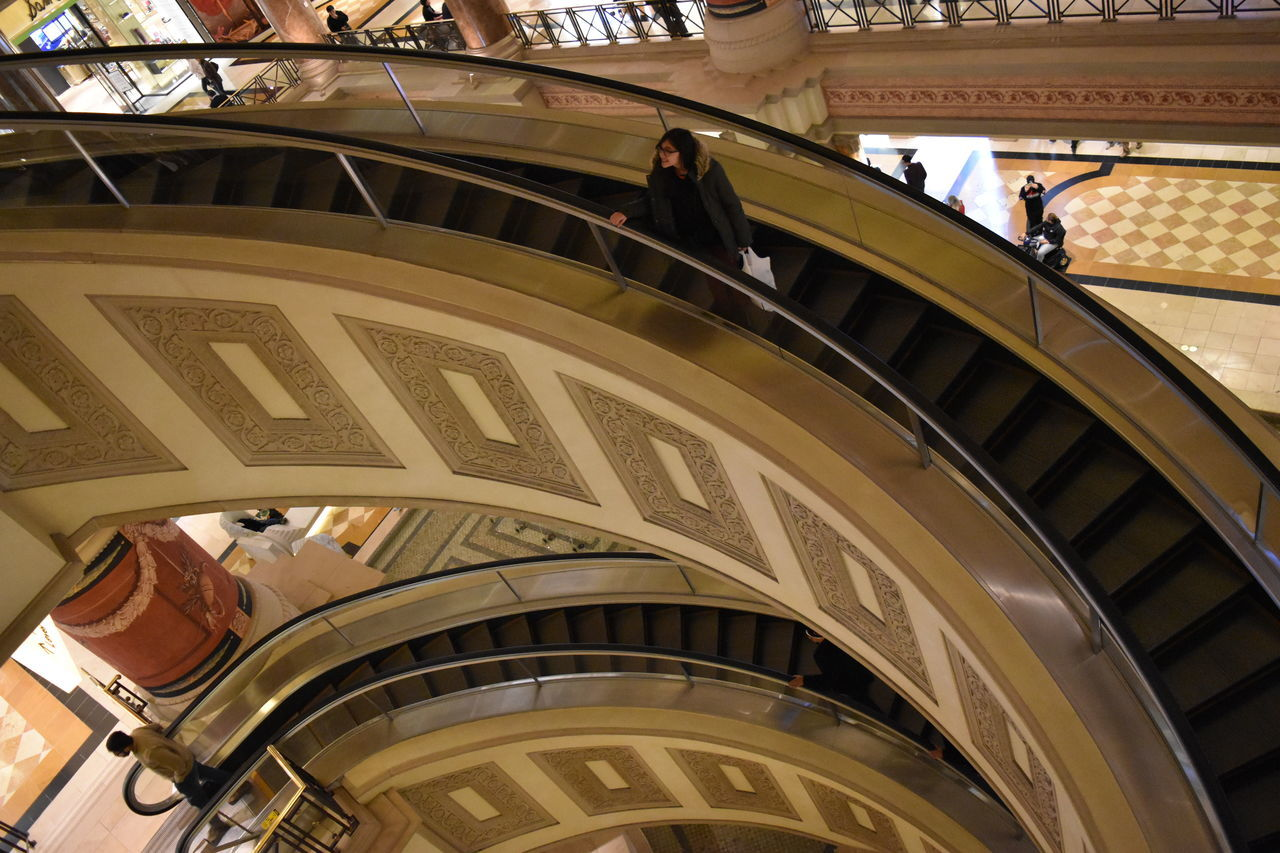 architecture, built structure, steps and staircases, staircase, real people, steps, men, low angle view, indoors, building exterior, day, travel destinations, lifestyles, large group of people, people