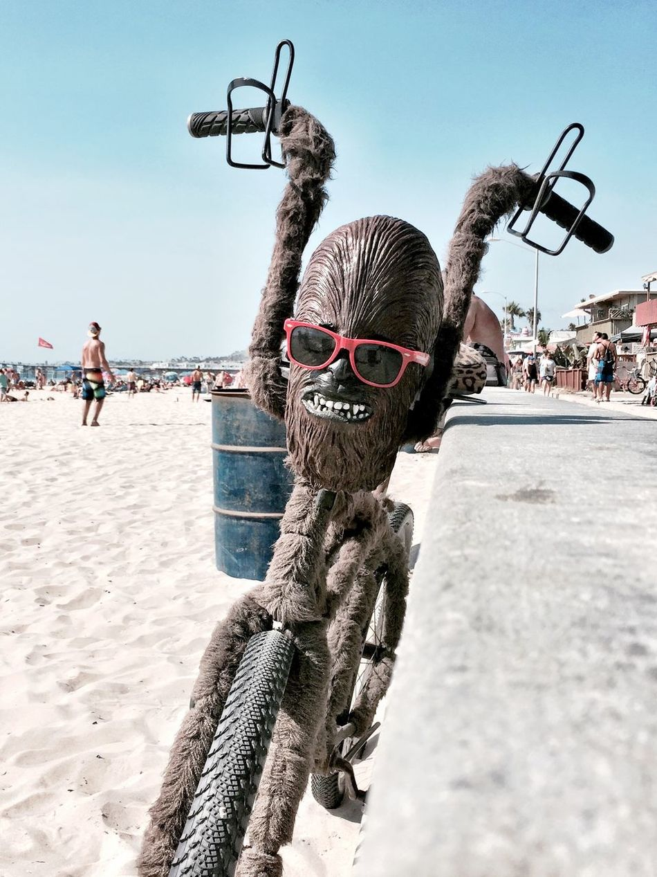 A fuzzy, Chewbacca bike with cup holders and sunglasses. Nothing unusual in a beach town. Awesome Beach Beachphotography Bicycle Bike Boardwalk Chewbacca Chewbaccalove Cool Eclectic Mission Beach Mission Beach,San Diego Outdoors Ride San Diego Star Wars Unique