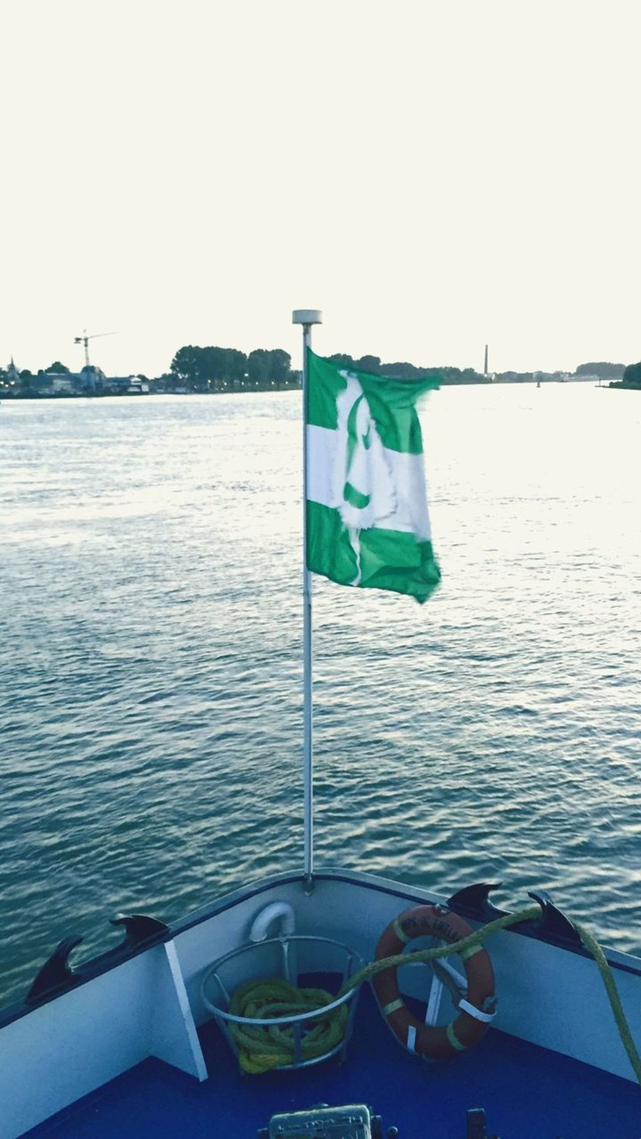 Flag leaving the harbour.... Eye4photography  Outdoor Photography Taking Photos Skyline Rotterdam Architecture Cityscape Urban Skyline EyeEm Best Shots Eyeemphotography Photography Taking Photo Taking Pictures Green Color Wind Day Freedom Pride Water No People Clear Sky Sea Outdoors Sky Nature