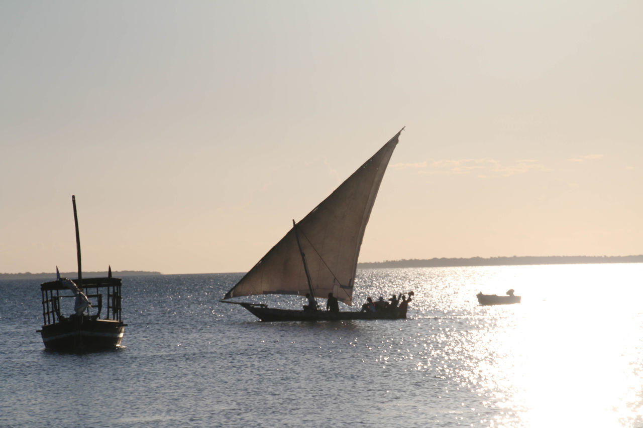Sail boat and Fishing boat in a sunset in Zanzibar Beauty In Nature Day Nature Nautical Vessel No People Outdoors Sailboat Sailing Sea Sky Sunset Transportation Water