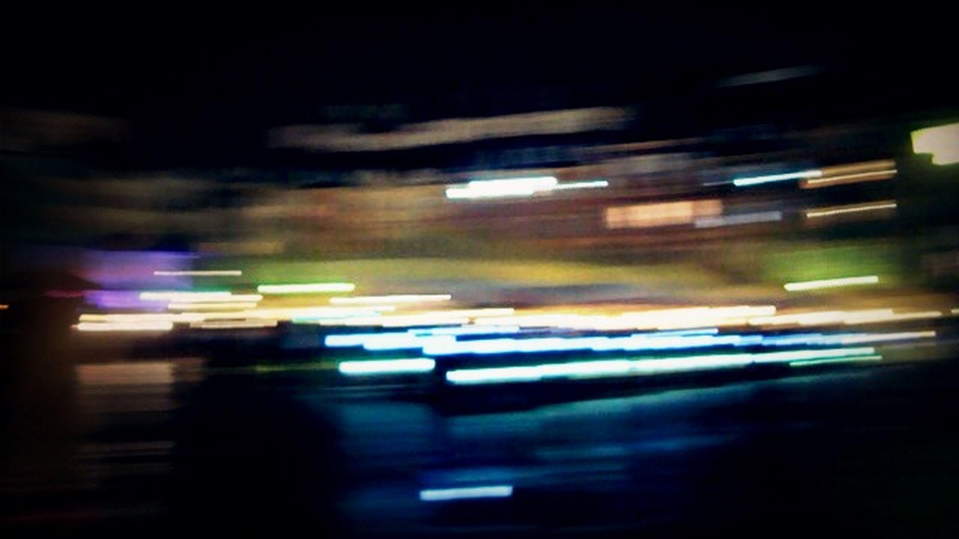 transportation, night, illuminated, car, mode of transport, land vehicle, street, blurred motion, on the move, road, motion, defocused, city, rain, traffic, travel, wet, indoors, speed, city life