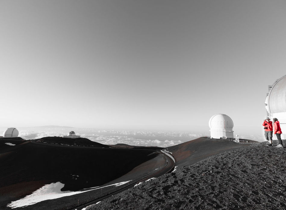A couple on the top of Mauna Kea's Summit Area Hawaii, the big island Architecture B&w Beauty In Nature Black And White Built Structure Clear Sky Cold Temperature Day Landscape Mauna Kea Mountain Nature No People Observatory Outdoors Scenics Sky