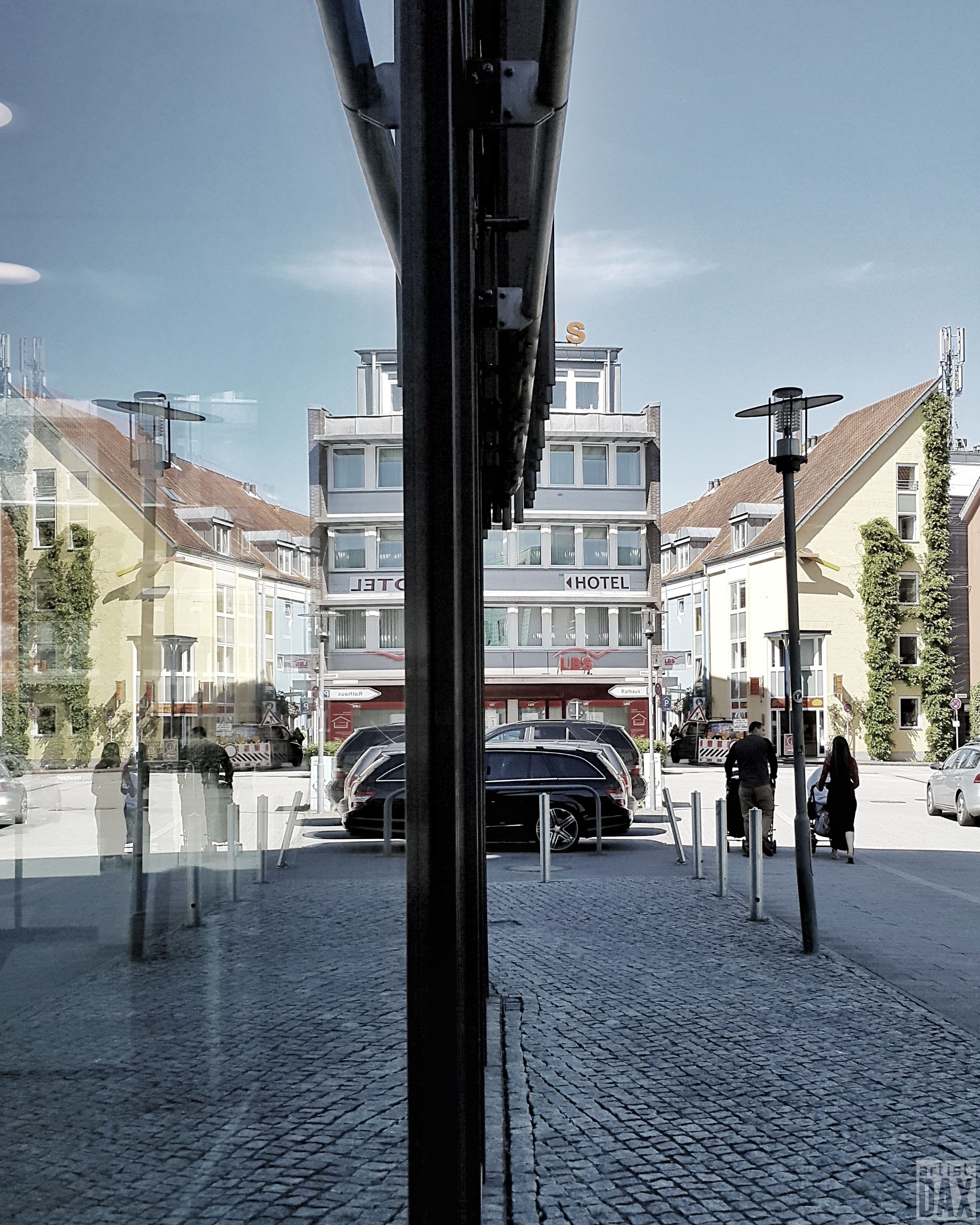 street, architecture, built structure, building exterior, transportation, sky, real people, road, city, outdoors, day, land vehicle