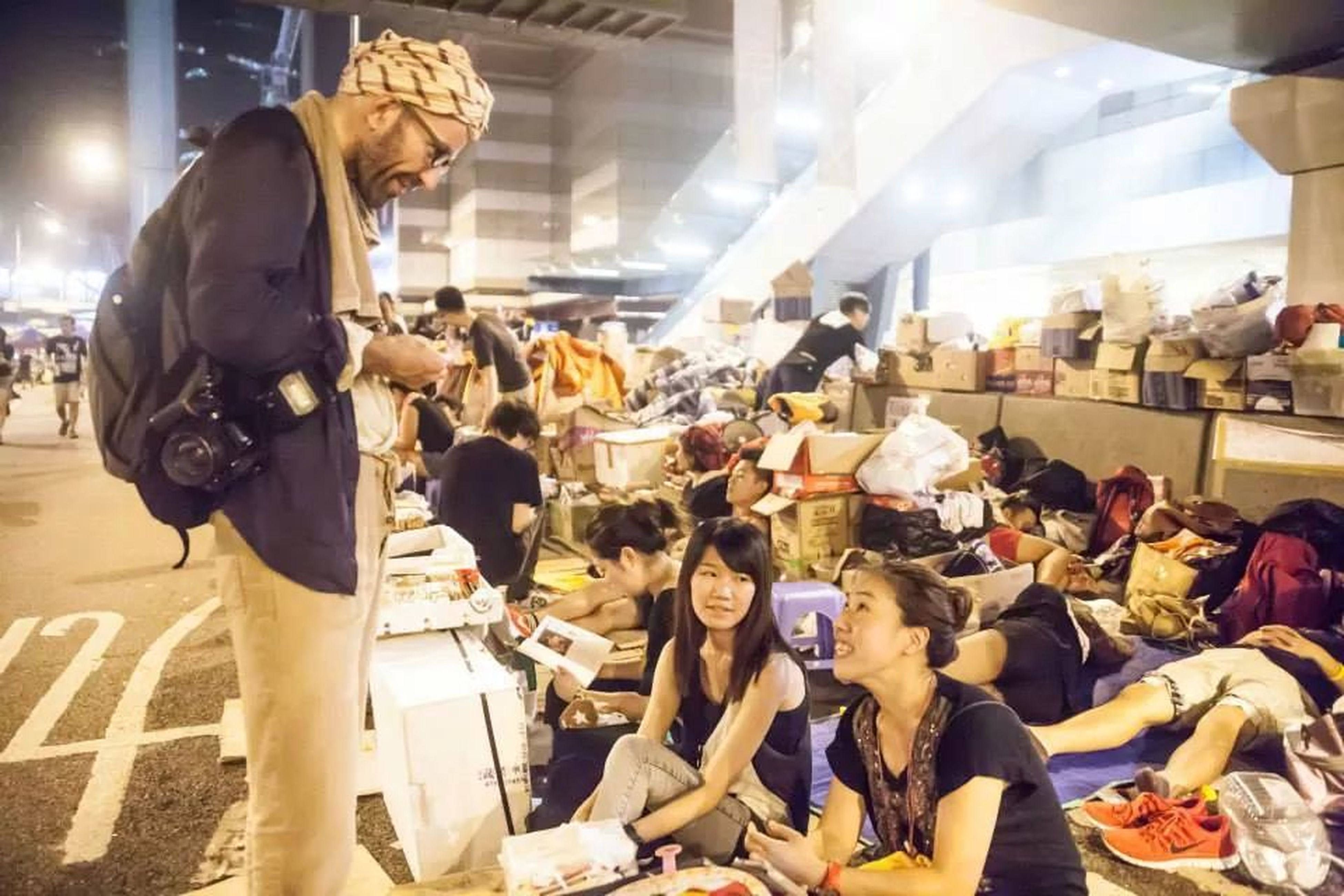 indoors, men, person, lifestyles, large group of people, leisure activity, sitting, retail, standing, shopping, medium group of people, market, for sale, store, crowd, market stall, casual clothing, consumerism
