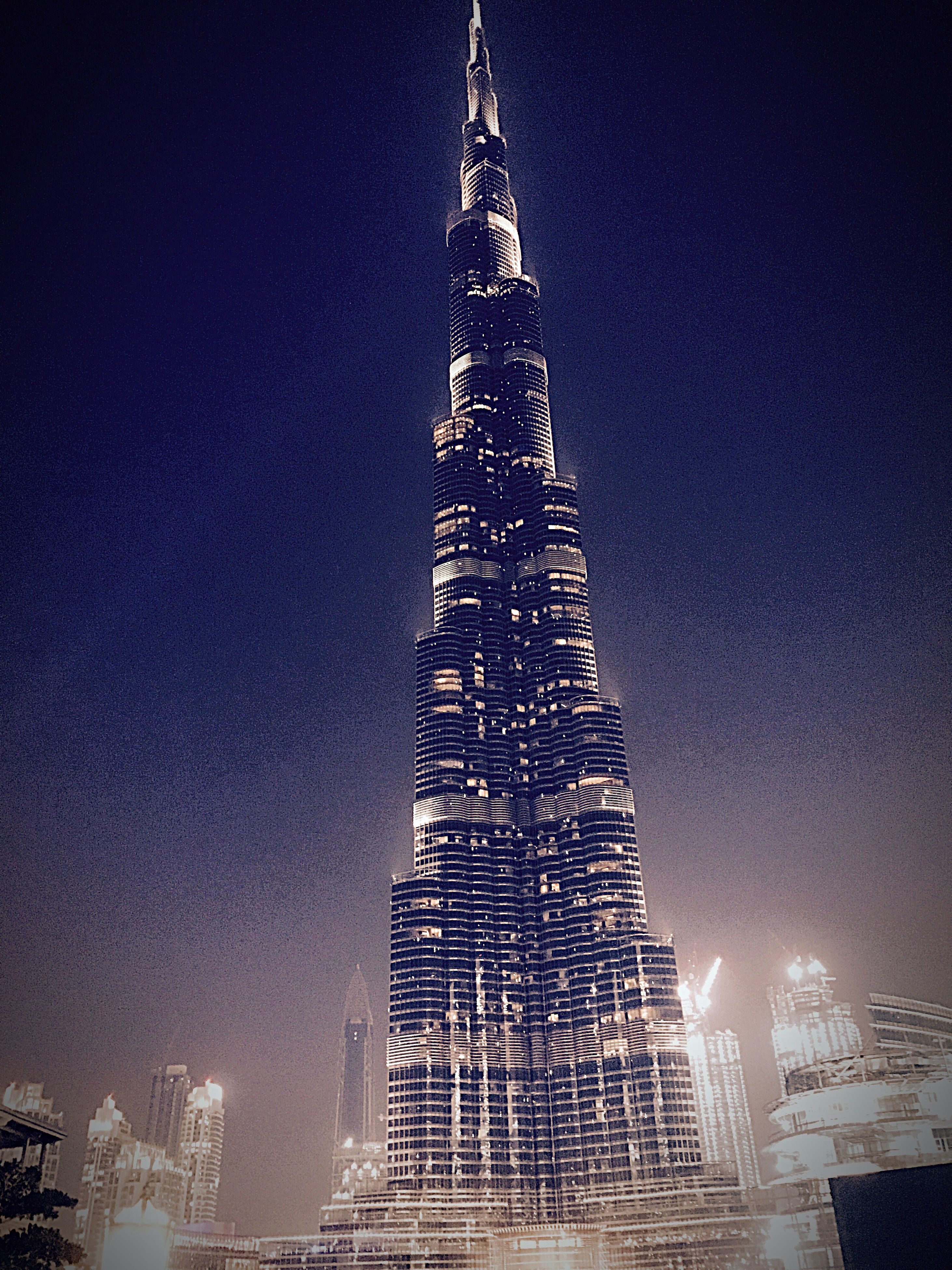 tall - high, tower, city, architecture, sky, night, skyscraper, illuminated, travel destinations, built structure, building exterior, no people, low angle view, outdoors, cityscape