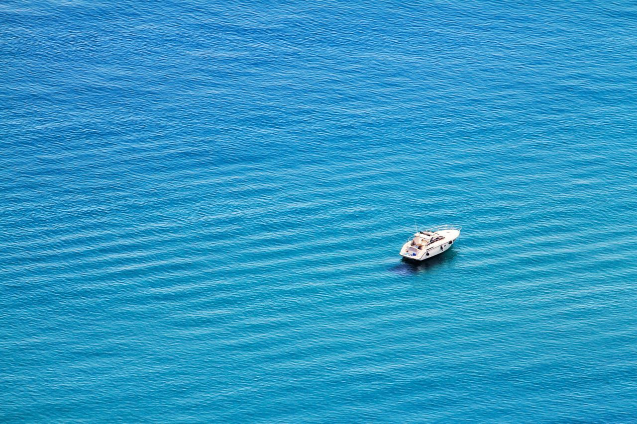Boat Speedboat Speed Boat Anchored Boats Blue Water Azure Seas Blue Sea Waves Ondulation Calm Sea Calming Relaxation Holiday Holidays Summer Travel Traveling Color Palette Popular Photos Flying High EyeEm Best Shots EyeEmBestPics Taormina Sicily Italy MISSIONS: The Great Outdoors - 2017 EyeEm Awards