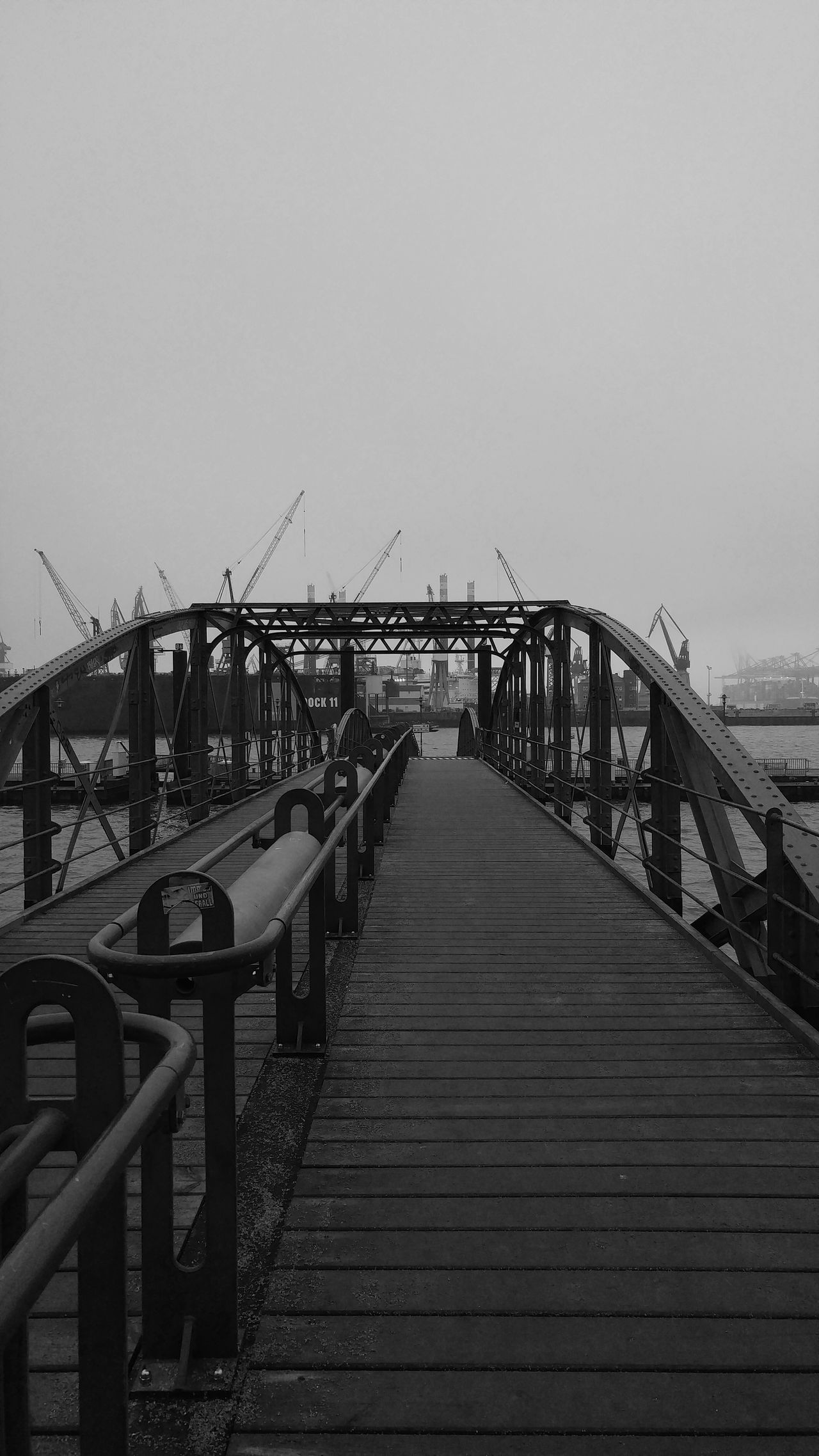 Into the water Bridge - Man Made Structure Outdoors Steps And Staircases Elevated Walkway No People City Travel Photography Outdoor Photography Cityscape Urban Exploration From My Point Of View Eyeem4photography Harbour View Day Fog Walking At The River Looking At Things Miles Away Vanishing Point EyeEm Best Shots - Black + White Blackandwhitephotography Monochrome Photography Monochrome