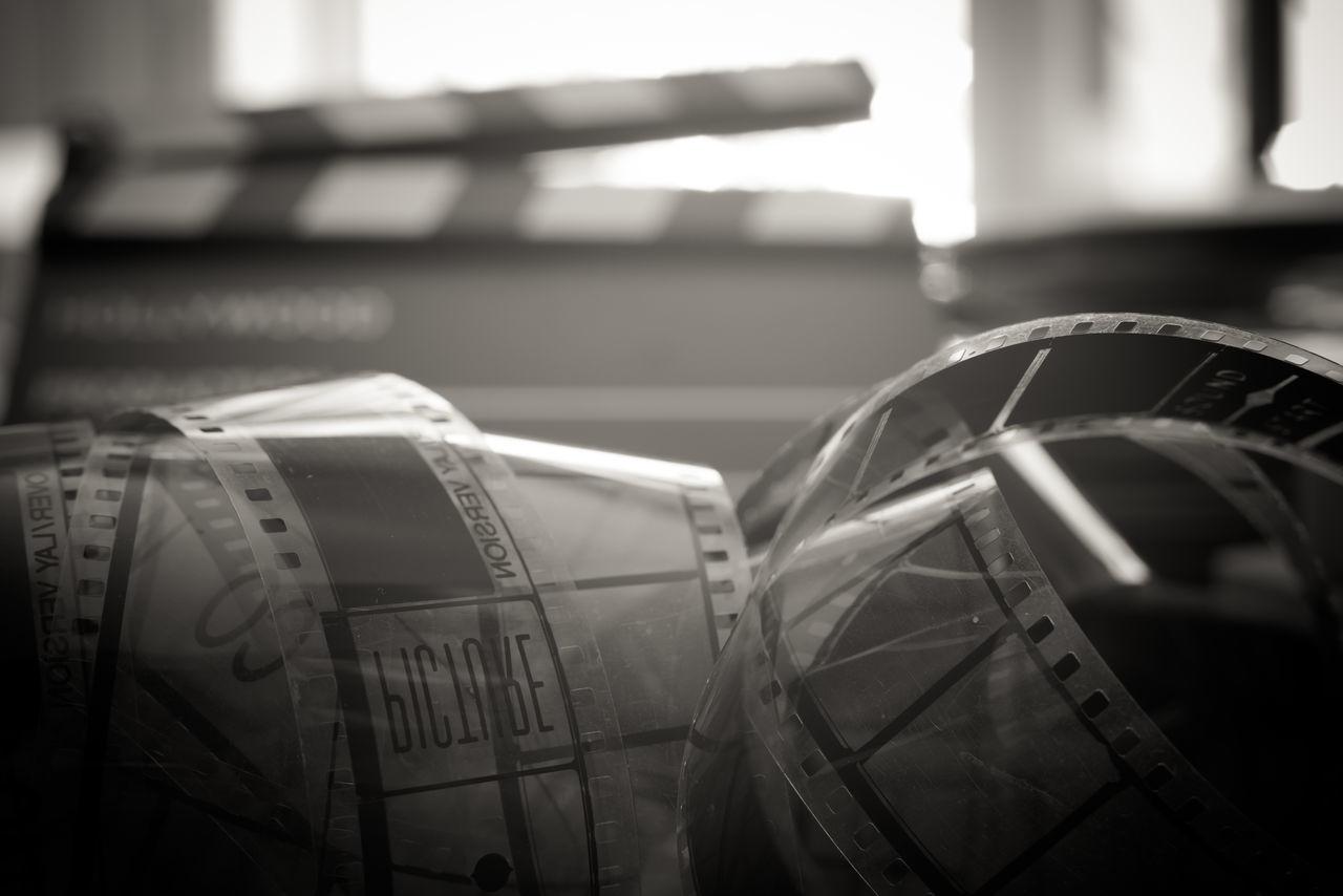 35 mm film vintage black and white 35mm Film Black And White Celluloid Clapper Clapperboard Film Film Head Film Header Filmstrips MOVIE Reel Roll Selective Focus Vintage