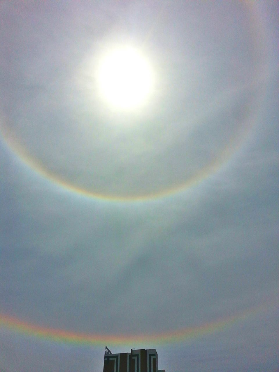 rainbow, sky, sun, low angle view, no people, sunlight, day, outdoors, nature, beauty in nature