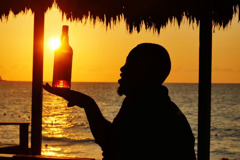 Sun-Downer Sunset Silhouette Sea Water Real People Beach Orange Color