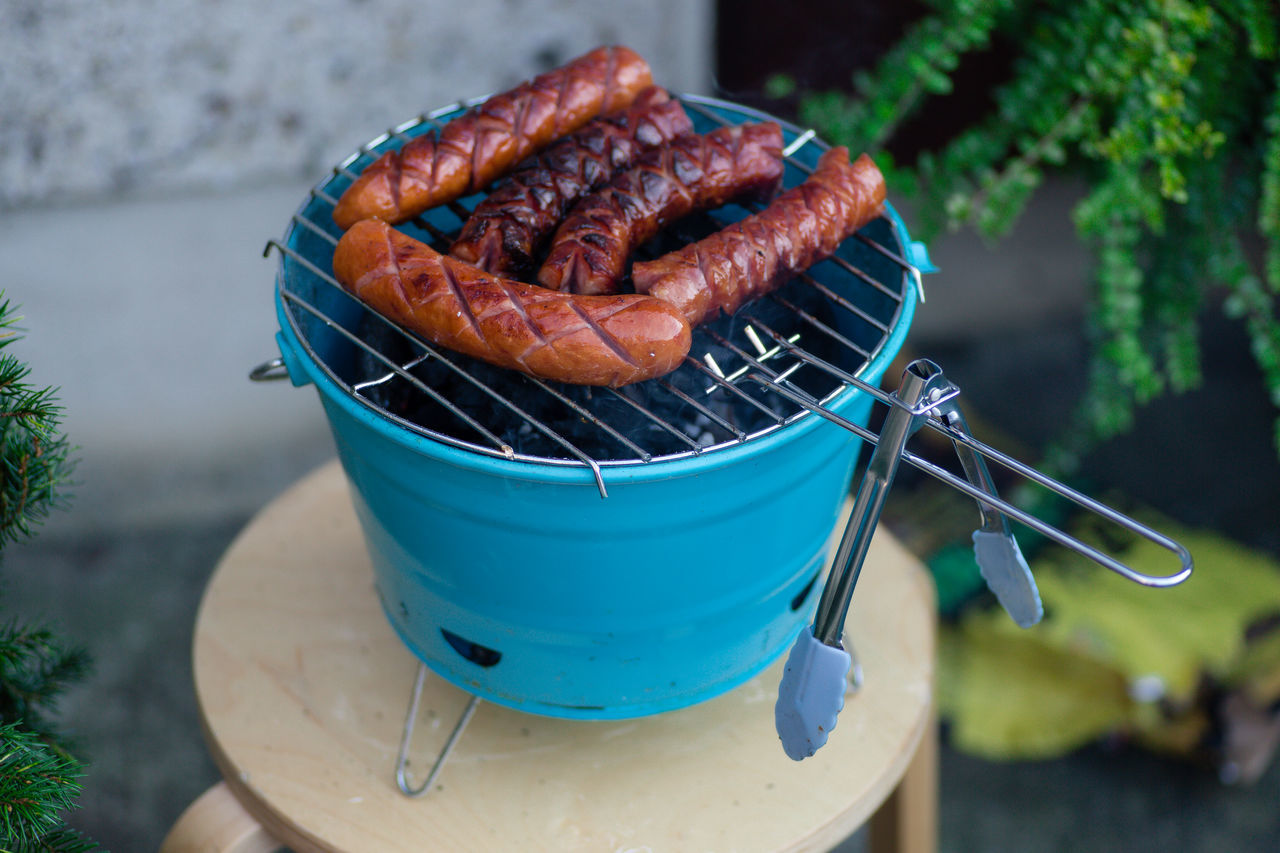 Sausages being grilled on a small barbecue Barbecue Bbq Clamp Beef Burned Eating With Friends Fire Food Food And Drink Fried Grill Grilled Grilling Meat Hot Food Hot Food Smoke Meal Outdoors Portable Bbq Roast Roasting Sausage Sausages Smokey Tasteful Tasty Weekend