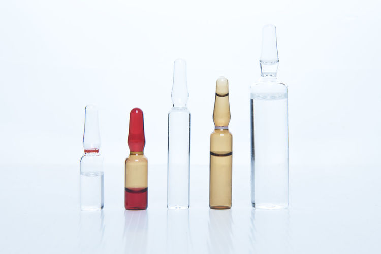 Medicine Ampules and Vials Ampoule Ampoules Hospital Hospitality Illness Liquid Medical No People Studio Shot Vaccination Vial Vials White Background