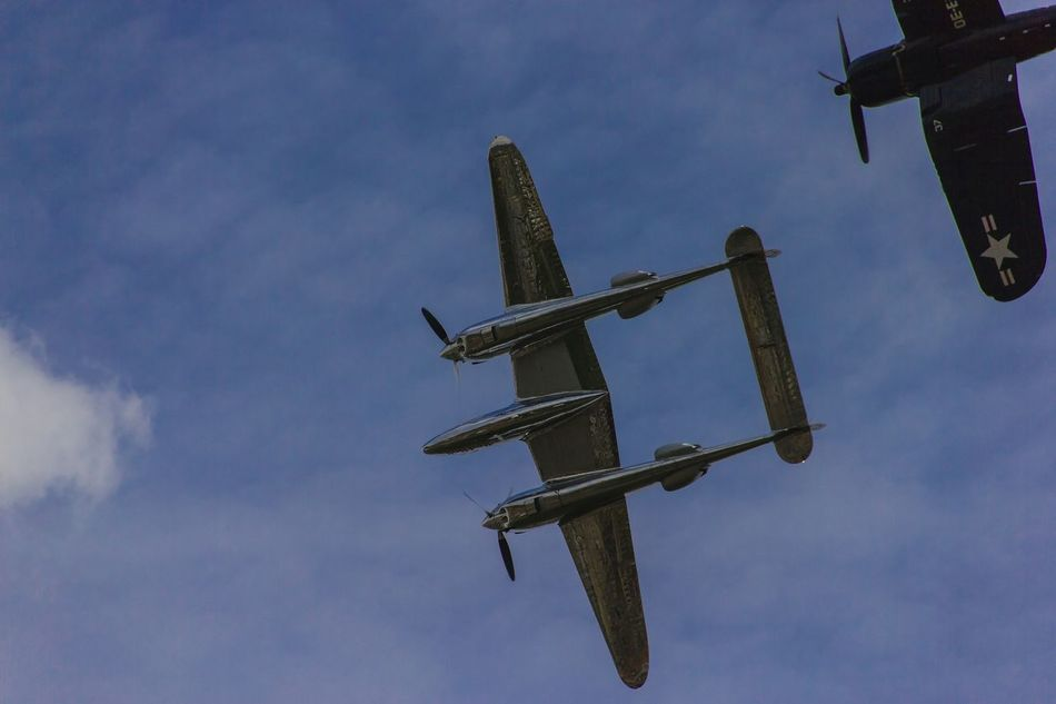WINGS OF LIBERTY. A P-38 Lightning flies through the sky of Budapest escorted by a F-4U Cosair during the Red Bull Airrace at the annual Day of Foundation of the State, 20th august 2015. Warplane WwII Airplane F-4u Corsair F4U Corsair Fighterplane Airshow P-38 Lightning