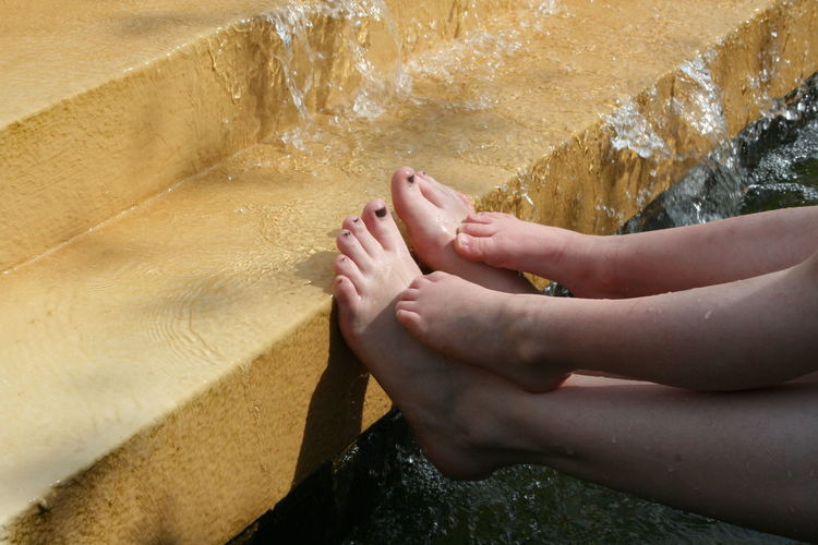Child Feet Child Foot Day Feet Flowing Water Fountain High Angle View Human Feet Human Foot Low Section Outdoors Person Personal Perspective Relaxation Sitting Solitude Togetherness Tranquility Water Young Adult Young Women