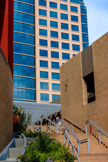Contrasting Buildings Exploring Stairs Arch Architecture Blue Building Exterior Built Structure City Day Downtown District Low Angle View Mixed Use Modern No People Outdoors Outside Photography Sky Staircase Steps Steps And Staircases Street Photography Tree Urban Urban Art Walking Window