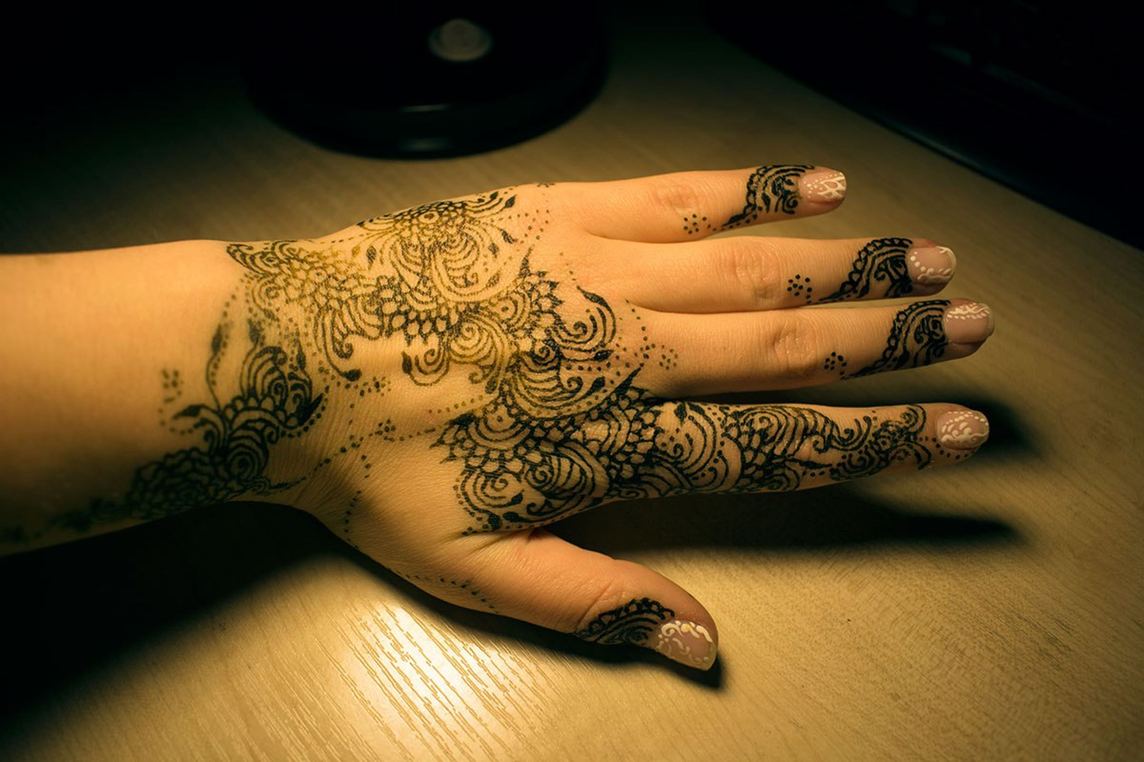 human hand, tattoo, art and craft, cultures, indoors, human body part, table, close-up, ink, one person, people