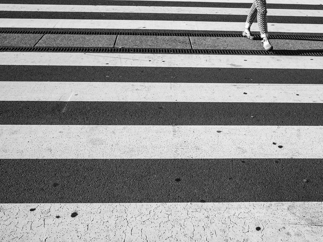 Lines will be lines Black And White Crosswalk Feet Human Body Part Low Section Monochrome No People One Person Outdoors People Road Road Marking The City Light Transportation Unrecognizable Person Walking Zebra Crossing